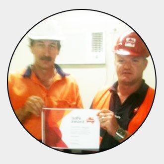 two men receiving award