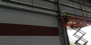 a roller door specialist finishing up an installation job