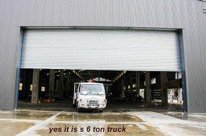 truck coming our of industrial door