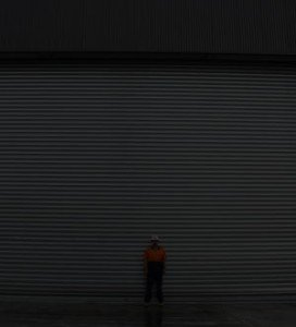 man in steel shutter door dark