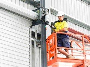 man fixing roller shutters